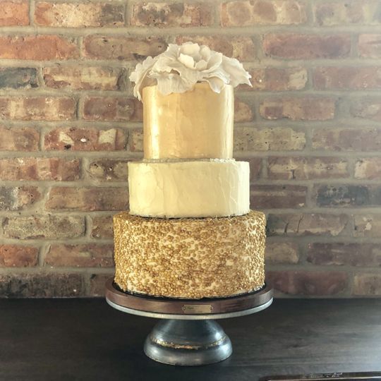 Gold sequins and sugar flowers.  Textured buttercream.