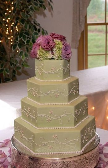 Buttercream tiers with hand-made sugar bugle bead embroidery.....