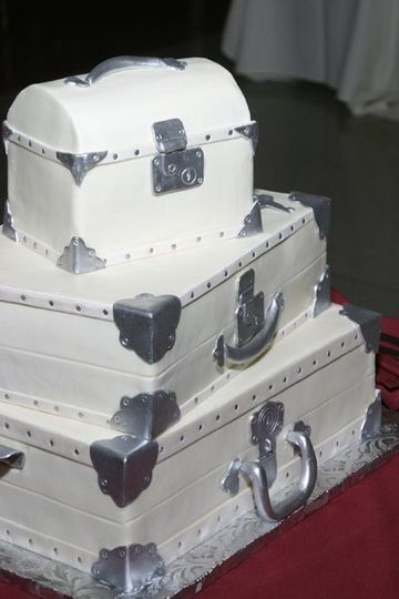 Buttercream trunks with hand-made sugar latches and hinges....