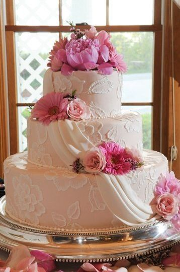 Hand-painted sugar embroidery, draped in sugar on pink buttercream tiers......