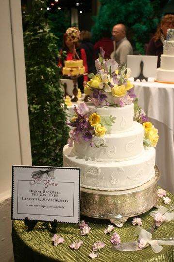 A profusion of spring flowers created in sugar, featured at the Boston Flower and Garden Show's...