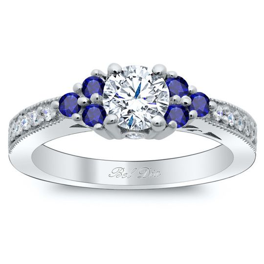 art deco diamond engagement ring with sapphire clu