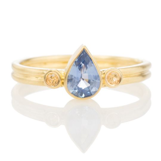 Blue sapphire engagement ring with yellow sapphires. One of a kind. Handmade in 18k yellow gold.