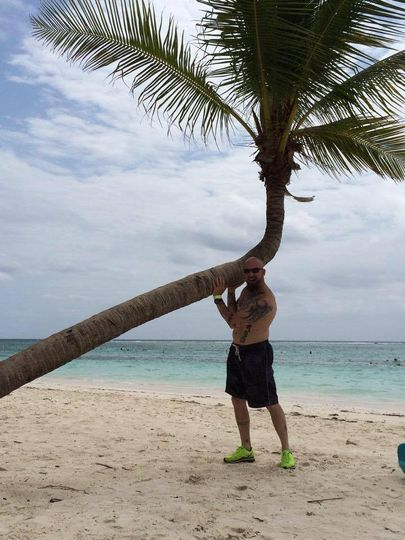 Kenny making sure the palm tree isn't falling.. Mexico was a lot of fun!
