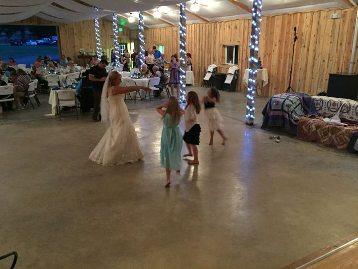Bride dancing the the kids