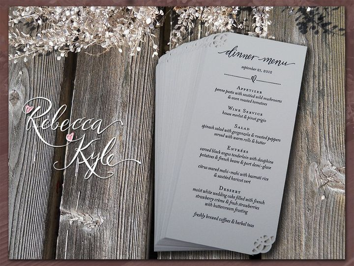 These sweet and simple letterpress menus feature hand lettered calligraphy with decorative punched...