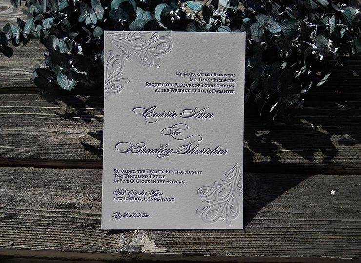 Custom designed and letterpress printed peacock wedding invitation in lavender. Printed on off white...