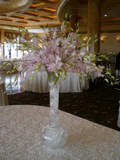 LAVENDER AND WHITE DENDROBIUM ORCHIDS IN TALL VASE