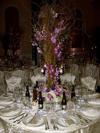UNIQUE CENTERPIECE DECORATED WITH ORCHIDS ON CURLY WILLOW BRANCHES, AVAILABLE IN A VARIETY OF...