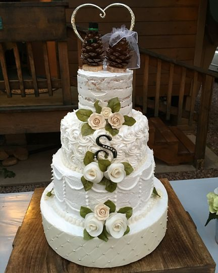 White Wedding cake with each tier a different design: Quilt, Curtain, Rosettes, Naked