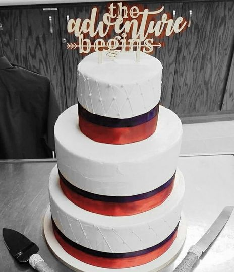 3 tier white wedding cake with two color ribbons and quilt design
