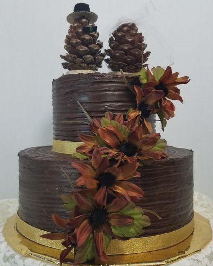 Rich Chocolate covered outdoor wedding cake