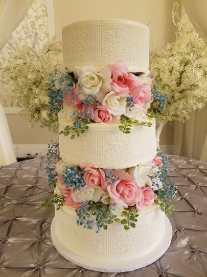 3 tier cake with flower separators and lace design