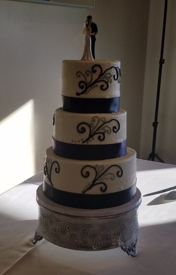 3 tier Gluten-Free cake with ribbon and scroll designs
