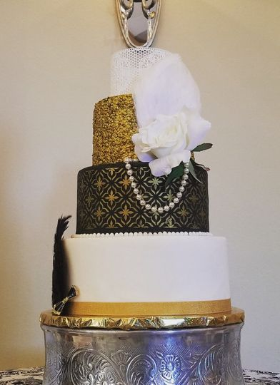 3 tier Roaring 20's cake with plain white fondant, gold stencil, and gold sequin designs