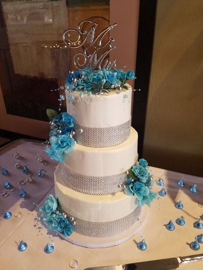 3 tier wedding cake with gem ribbon
