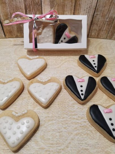 Bride and Groom heart shaped decorated cookies.