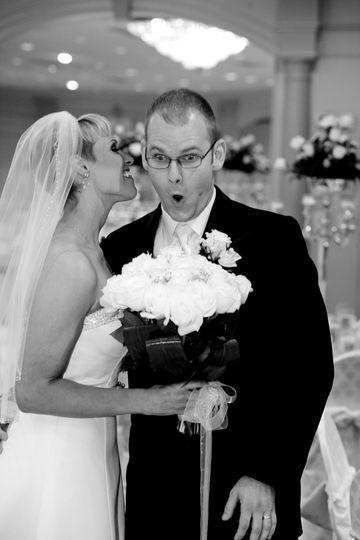 Bride and groom sharing secrets.