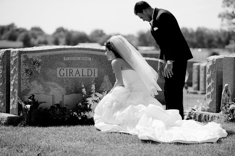 Bride and groom visiting the grave of the groom's mother.