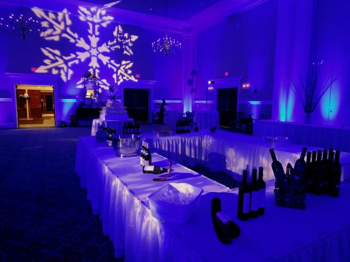 blue wedding uplighting with a winter snowflake flare for that winter wonderland look.