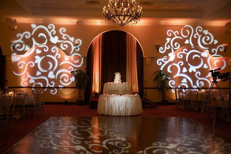 wedding lighting with gobo projection and a cake spot just for touch.
