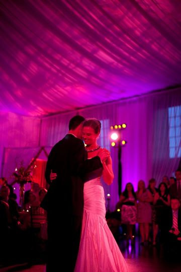 pretty in pink wedding uplighting with purple accents