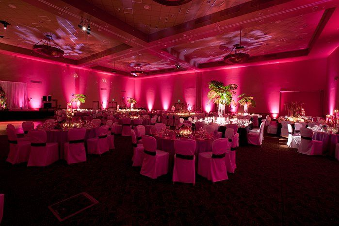 pink uplighting with texture projection on ceiling.