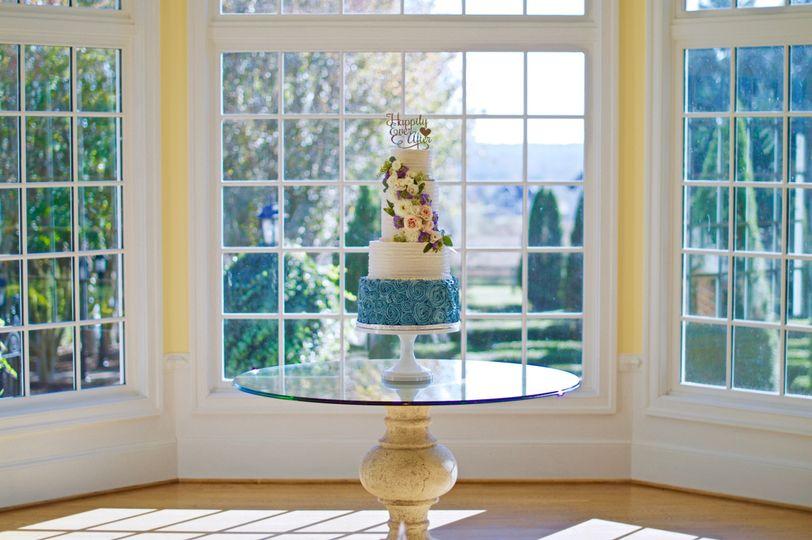 cornflower blue rosettes wedding cake
