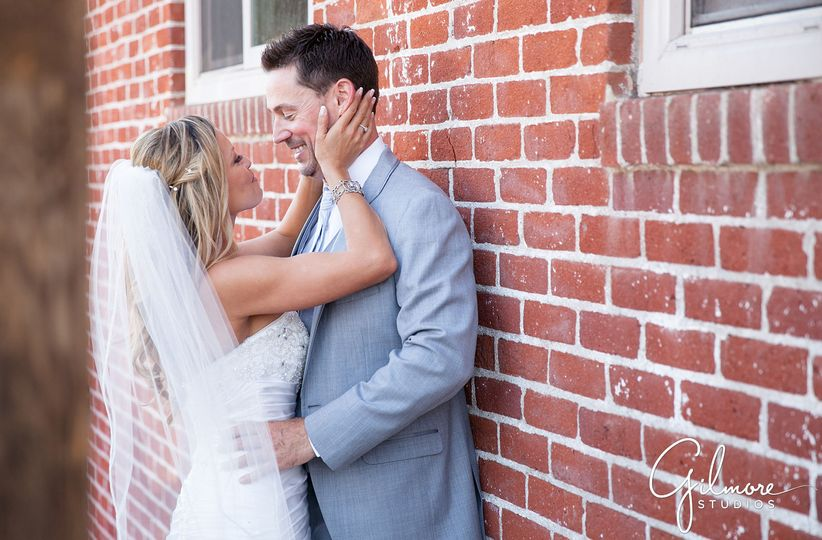 68f7c5603fa9b6a2 laguna beach wedding photographer brick wall romantic pose
