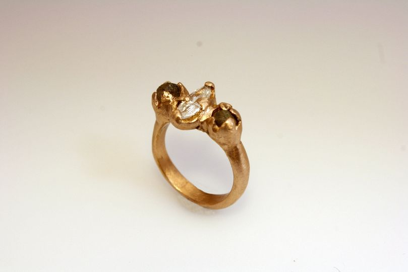 Custom cast 14kt rose gold engagement ring made with client's grandmother's diamond