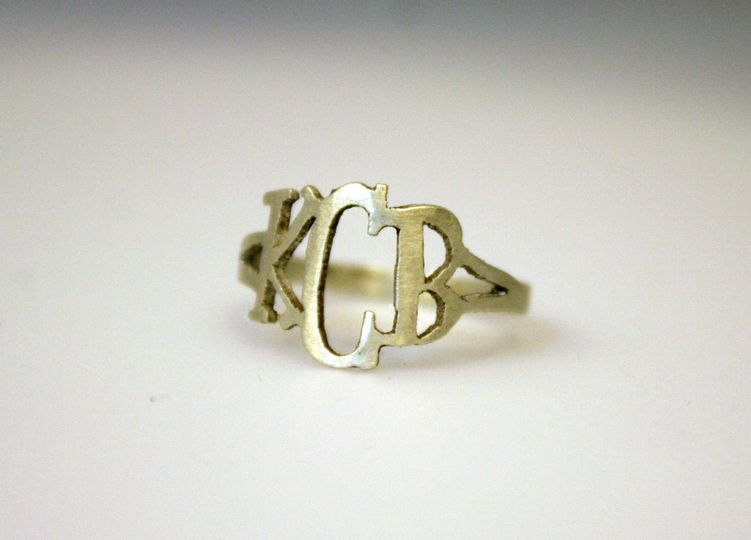 Custom, hand-cut initial ring in silver. Great for bridesmaids gifts!