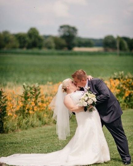 Newlyweds dip for a kiss