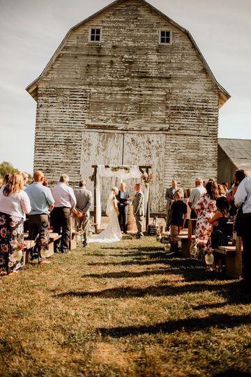 A rustic outdoor ceremony
