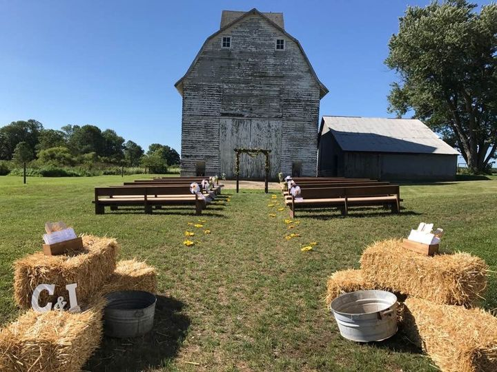 Simple country wedding setup with hay details