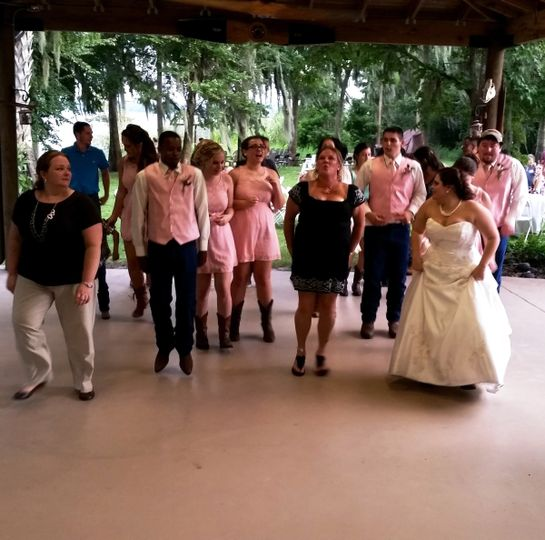 The bride leads this group dance