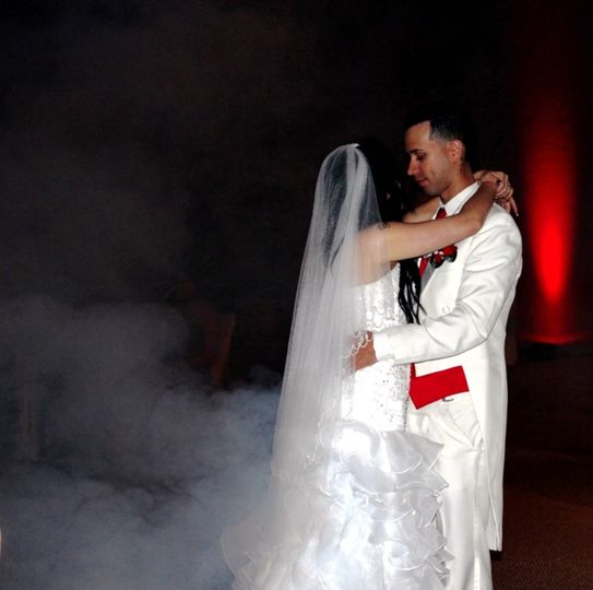 Couple dancing with up lights and fog