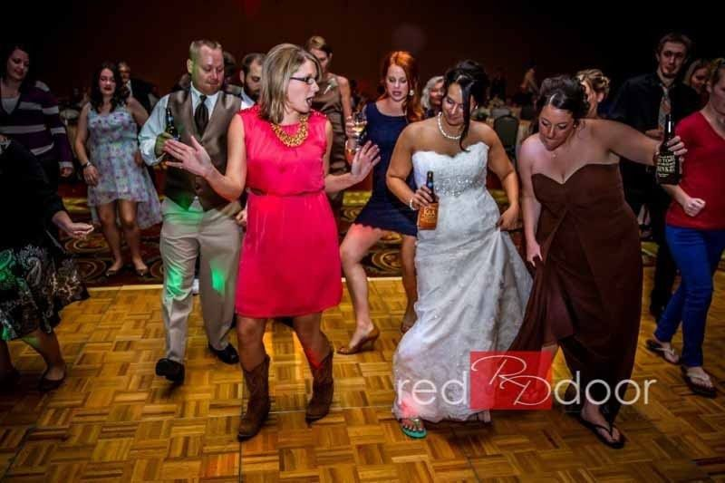The bride dancing with guests