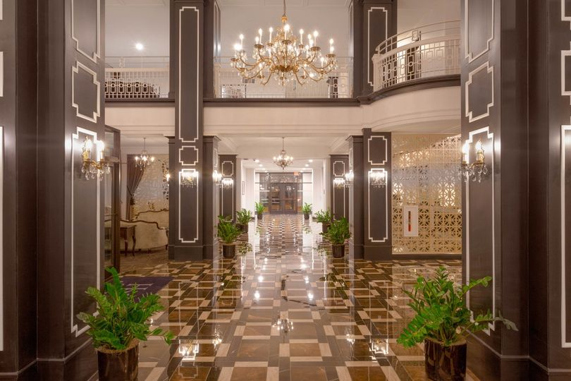 Chandeliers reflect off sparkling floors