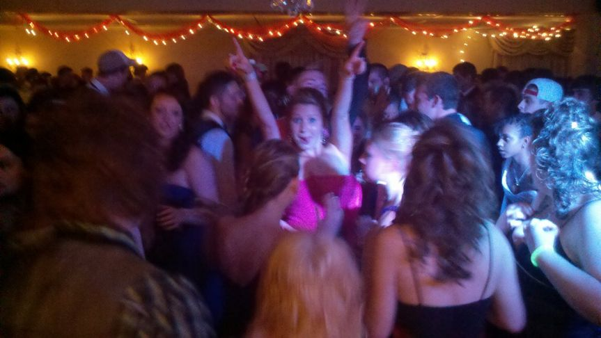 The bride and guests dancing