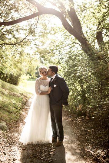Groom kissing his bride