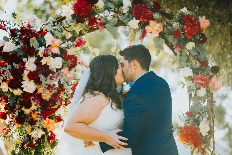 Love the reds and jewel tones in theis arch by McCann Flowers (Collective Perception Photography)