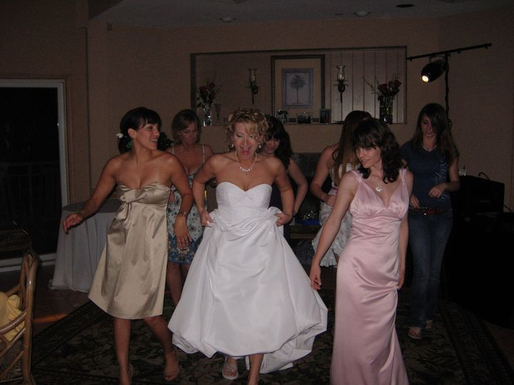 Bride with the guests dancing