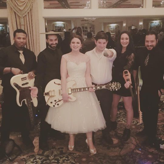 Bride carries the band's guitar
