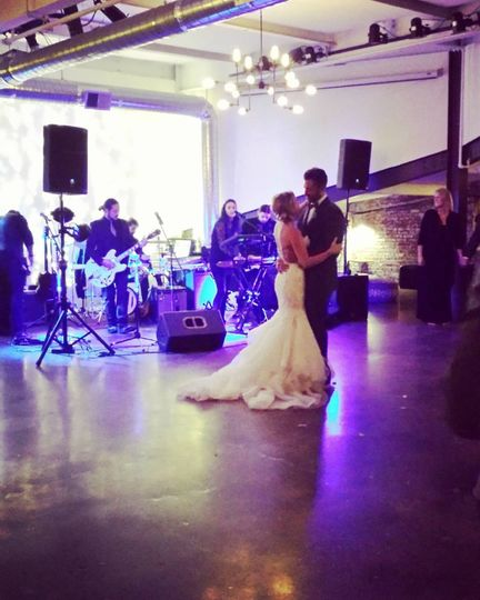 Newlyweds dance to the band's music