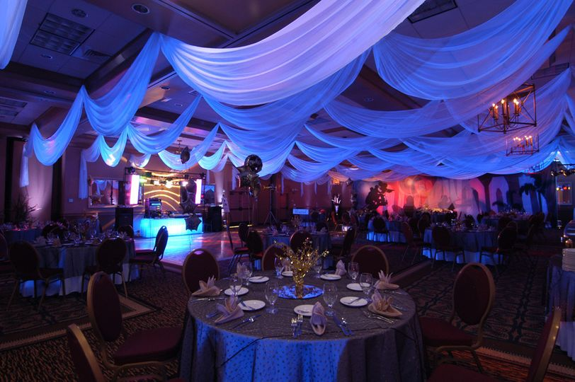 White chiffon ceiling treatments made to size by W Drapings for a birthday celebration. Photo by...