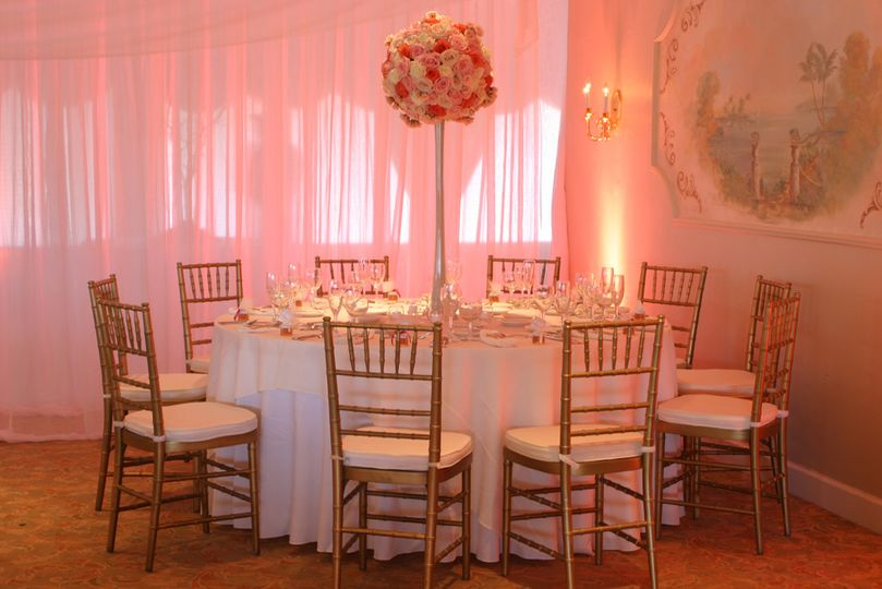 Classic pipe and drape in white chiffon by W Drapings for an intimate wedding reception. Photo by...