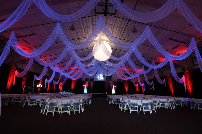 Custom event draping in white chiffon by W Drapings for a wedding reception in a sporting facility...