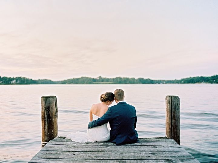 Newlyweds sitting on the dock