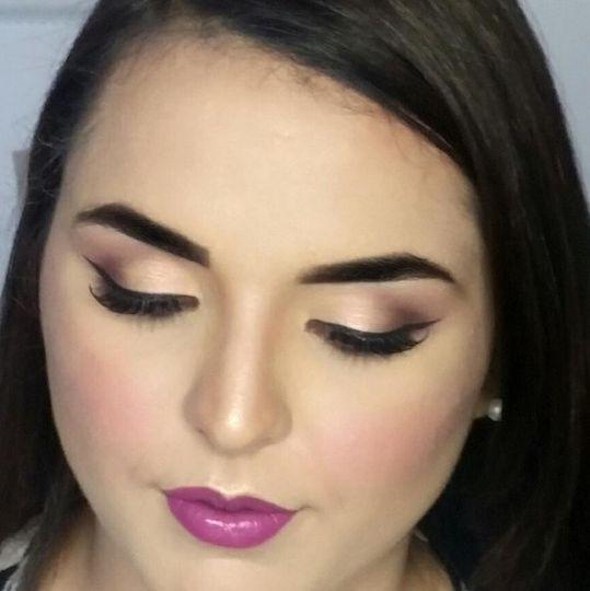 Bridal makeup with a gorgeous touch of color. #bridalmakeup #bridemakeup #purplemakeup