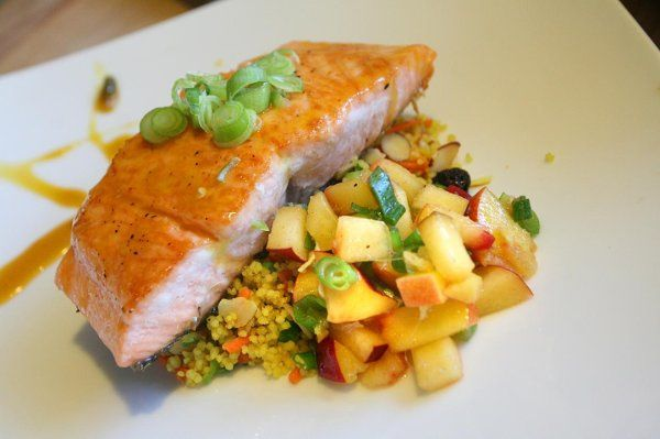 Citrus grilled salmon with nectarine salsa, curried cous cous and orange reduction.
